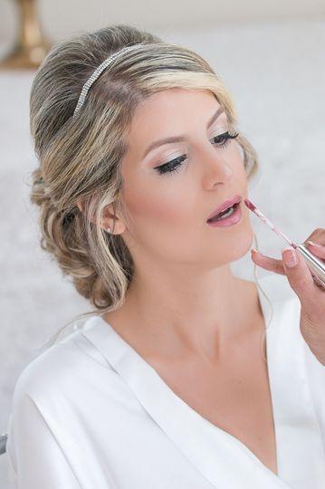 Putting on lip gloss