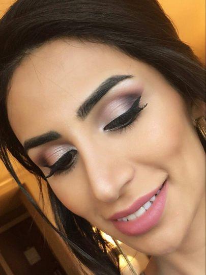Shimmery smokey eye with pink lip