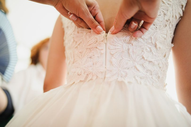 Helping the bride get dressed