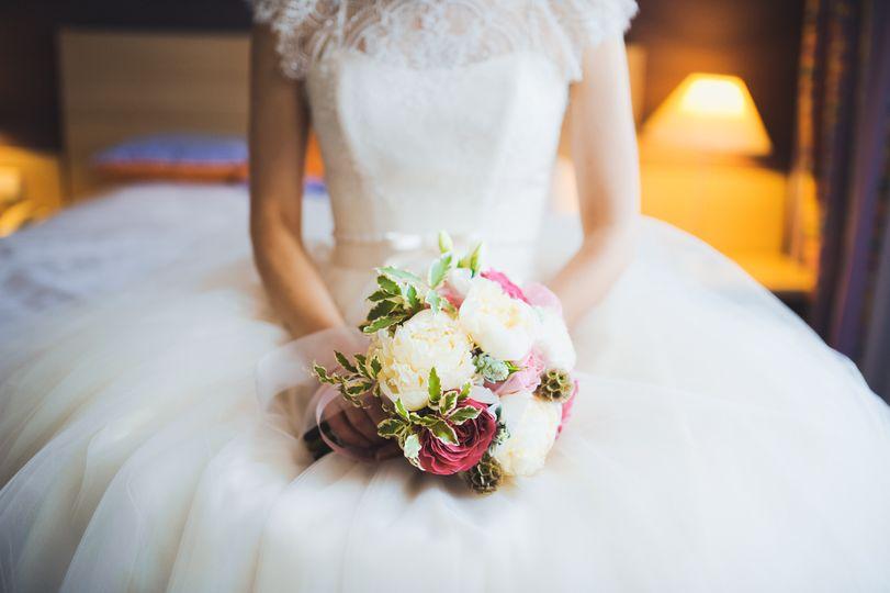 Holding a bouquet