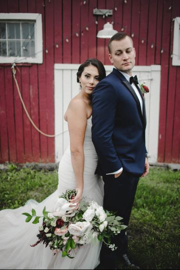 bride resting head on groom shoulder while holding