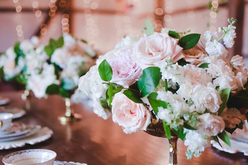 Blush and ivory centerpieces in a gold compote