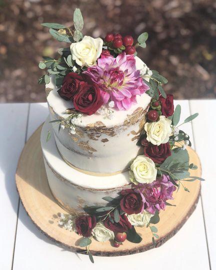 Naked cake cascading flowers