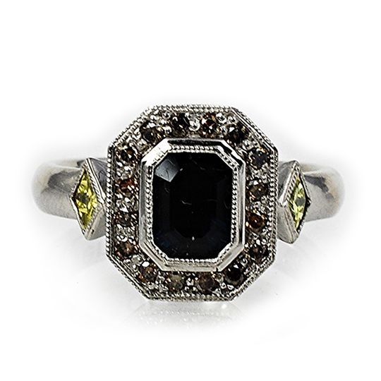 Palladium midnight blue sapphires, champagne diamonds, and yellow canary diamond alternative...