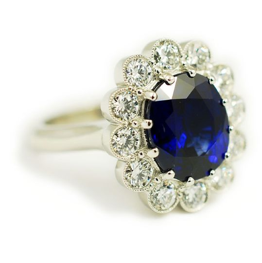 Platinum custom engagement ring featuring a 5.57 carat sapphire center sone and diamond accents -...