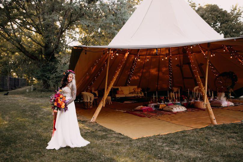 Bride by the tent | Brittyn Elizabeth Photography