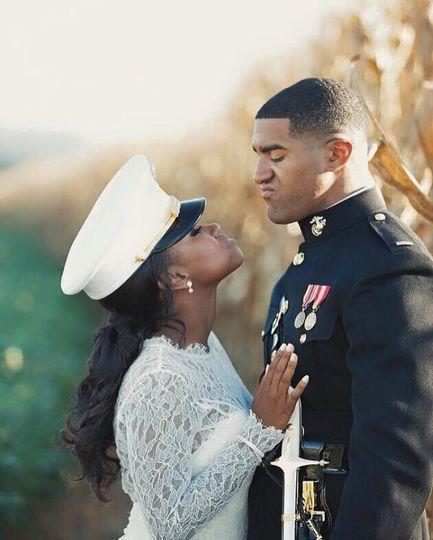 Bride wearing her groom's cap