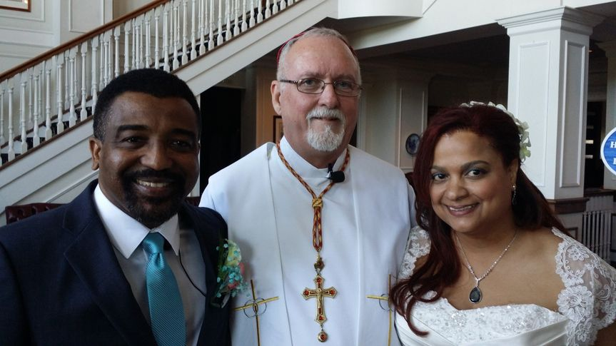 The bishop with the newlyweds
