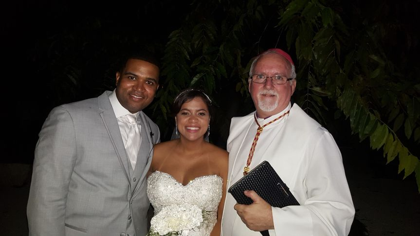 Groom and bride with the bishop