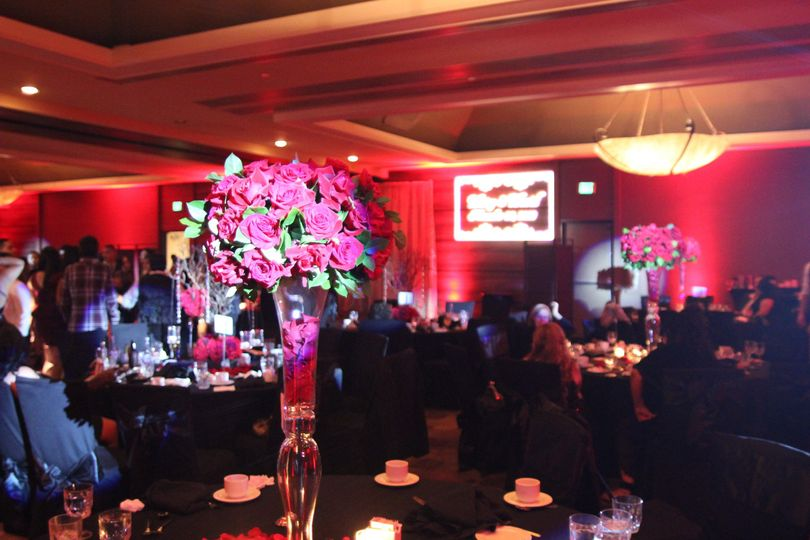 Red rose centerpiece, red uplighting, custom monogram projections.