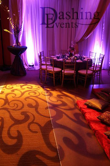 Golden gobo projection with lavender uplighting.