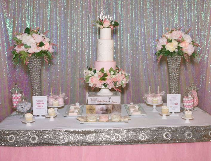 Floral cake and Brides Table with cupcakes, candy jars, decorated cookies and candy apples