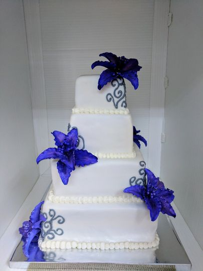 Rainbow marble layers inside this purple handmade Lily covered cake