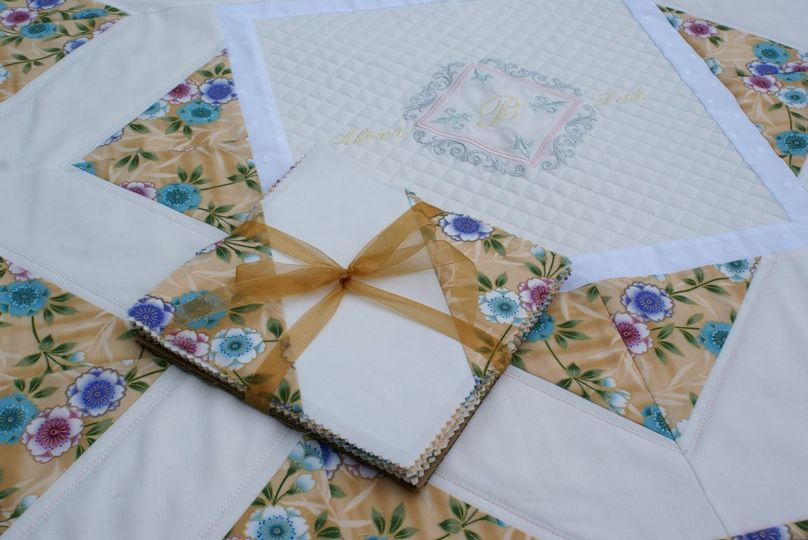 Sample of individual quilt squares and a center medallion.  Quilt squares are designed to be signed...