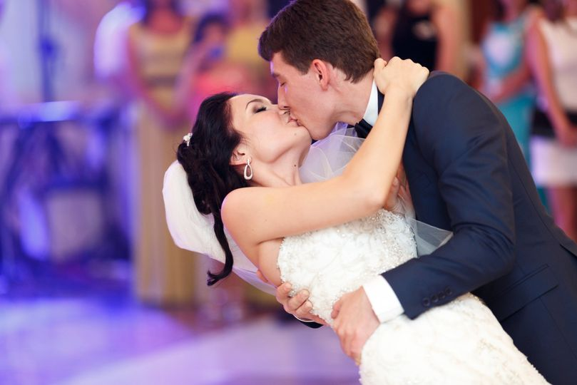 Groom dipping his bride for a kiss