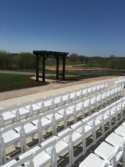Ceremony set with white chairs