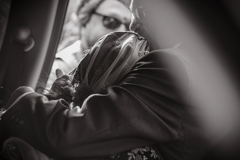 Embracing his bride