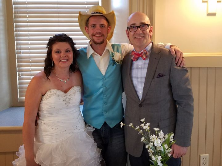 Couple with thw officiant