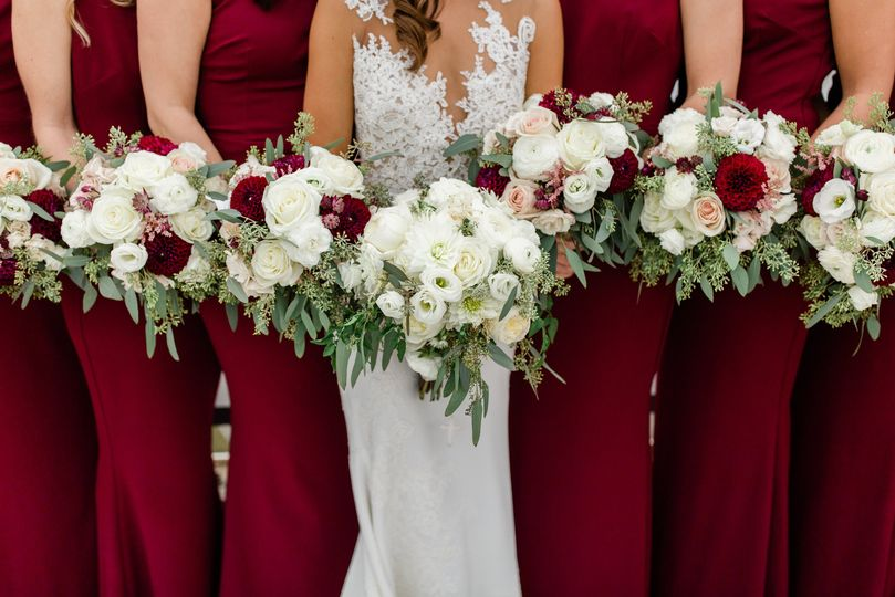 Bride and her bridesmaids in burgundy