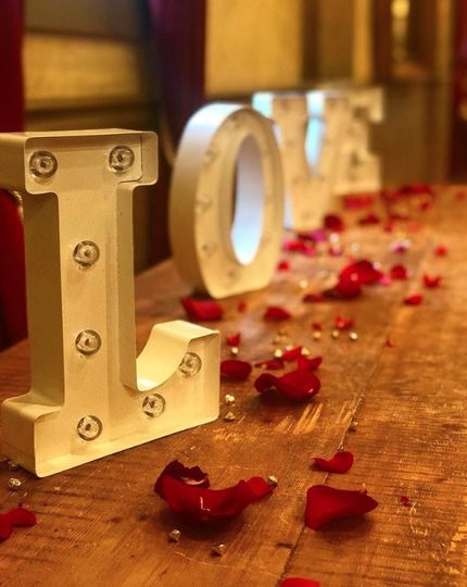 Rose petals by the love sign