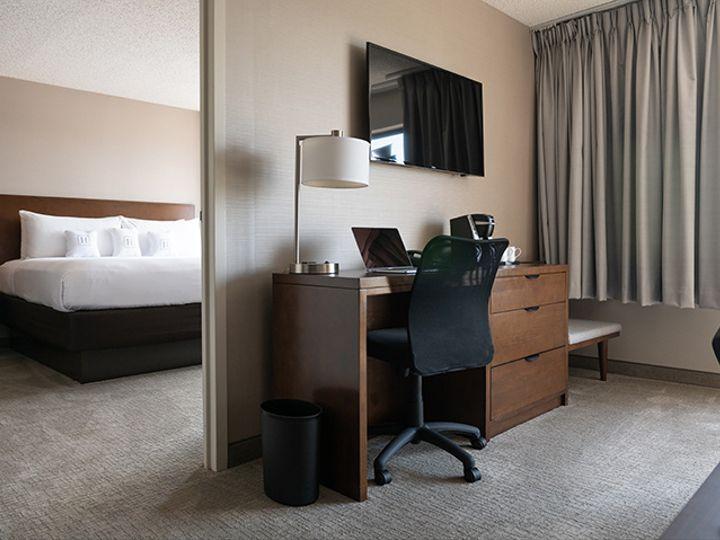 Tmx Harborside King Suite Seating Area Desk 51 1992097 160434482768713 Oxon Hill, MD wedding venue