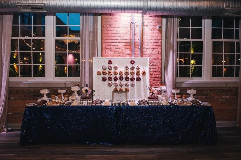 Doughnut wall dessert table for a wedding