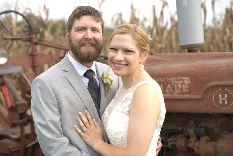 Couple in front of tractor