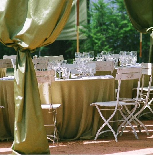 Fabric tent, tables, chairs, linen, and place settings at the Lynmar Estate. Courtesy of Lynmar...
