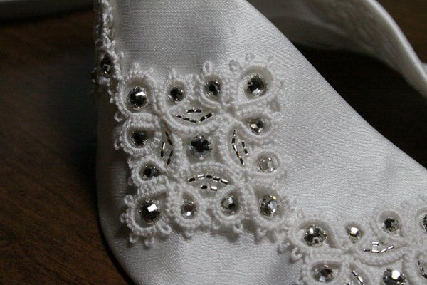 This is the tatted lace on the silk satin belt and beaded with swarovski crystals beads.