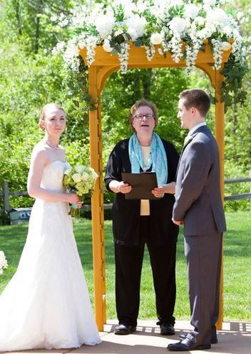Carolyn Burke Wedding Officiant performs a ceremony at the Lodge at Grant's Trail