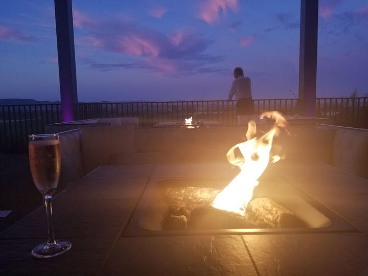 Terrace at dusk with fire pit