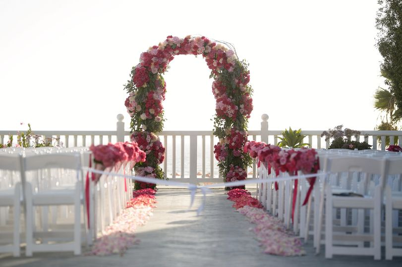 A romantic arch with garden roses, hydrangeas, peonies and many more.  The gradation of colors from...