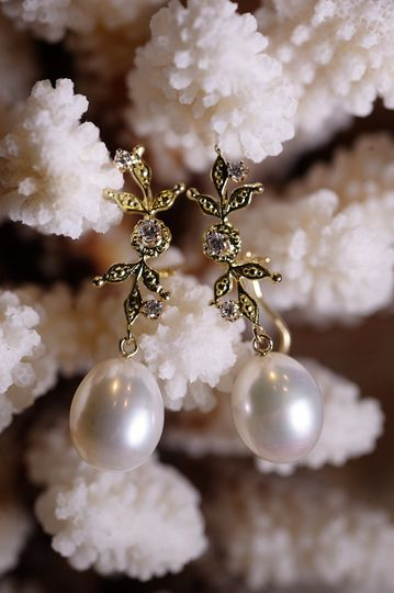 Drop earrings with pearls and diamonds.  The perfect accent to the wedding gown.