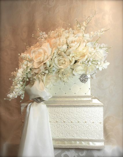"""$75.  Dimensions: 18"""" (bottom tier) 8"""" square base.  Upholstered in a matte cream satin or silk..."""