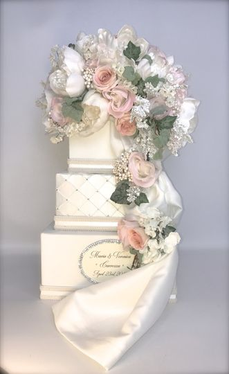 this card box is topped with cream roses, peonies, lilies of the valley, and hydrangea   Draping...