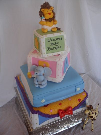 A 4 tiered fondant cake with edible sugar animals.