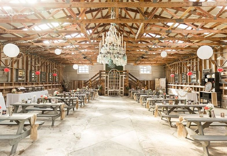 The Barn featuring a glass chandelier