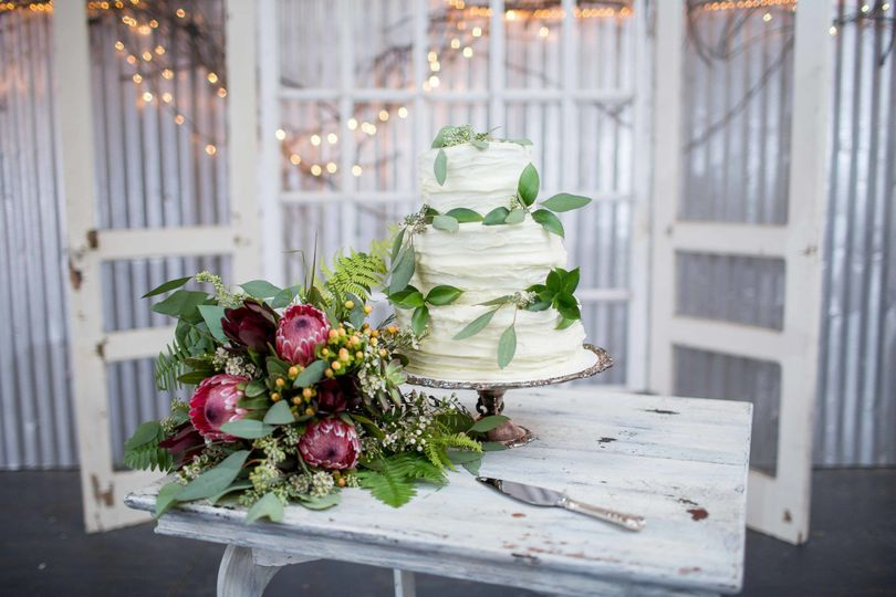 White wedding cake and fresh flowers