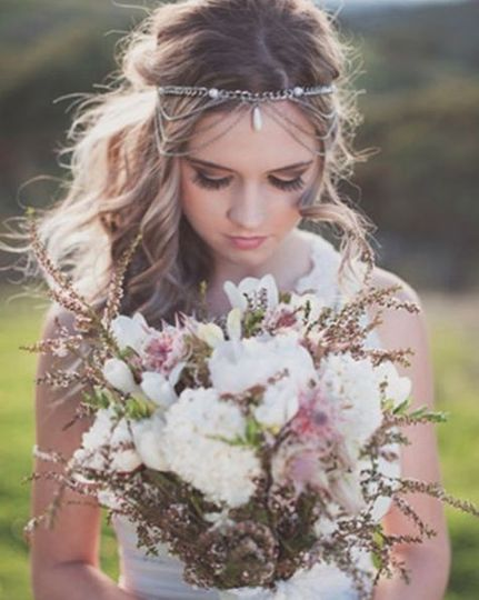 Pensive Bride Mona for her beautiful chic bohemian wedding in the Canyon