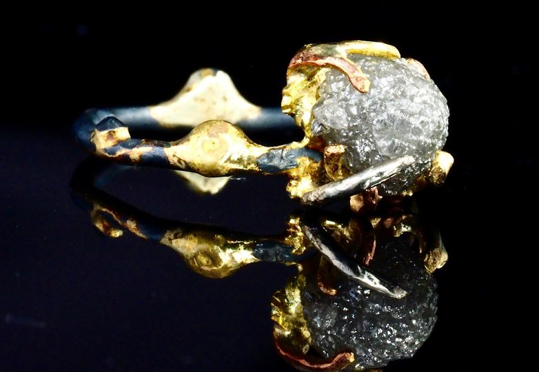 raw uncut white diamond mounted in oxidized silver and fused 18k gold band