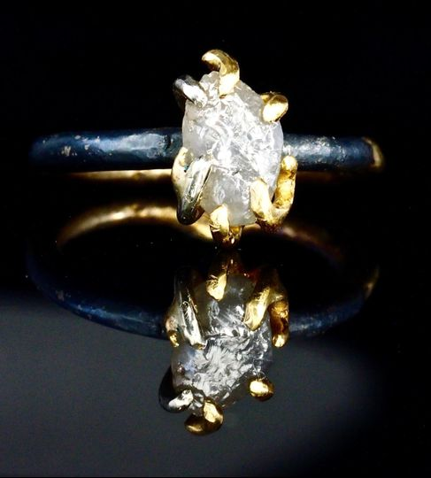 raw uncut white diamond mounted in 18k gold claws on oxidized silver and fused 18k gold band