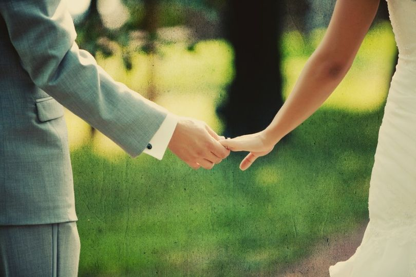 bride and groom holding hands wedding photography