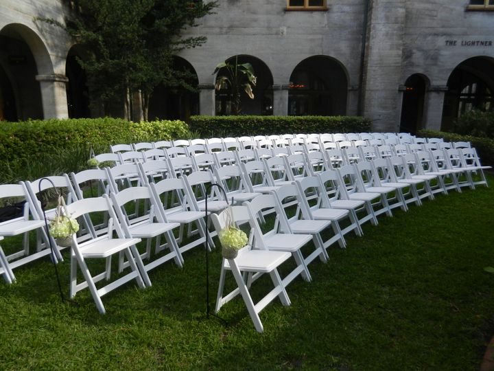 Aligned white chairs