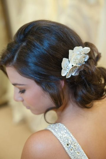 Curly hair updo complemented with white flowers