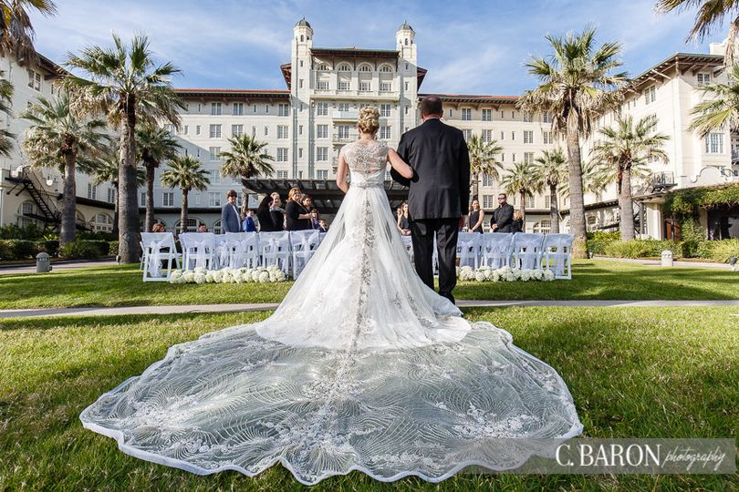 Ceremony on the center lawn of hotel galvez & spa. Photo by c baron photography.