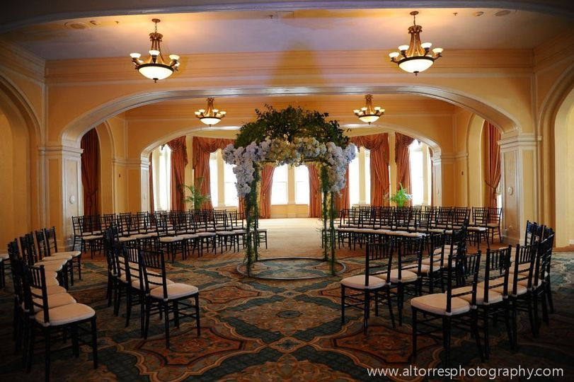 Hotel Galvez' Music Hall set for an elegant indoor ceremony. Photo by Al Torres Photography.