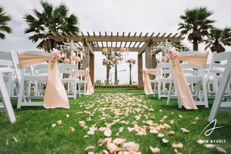 Hotel galvez' centennial green set for outdoor wedding ceremony. Photo by adam nyholt photography.