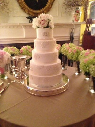 5-tier wedding cake with floral topper