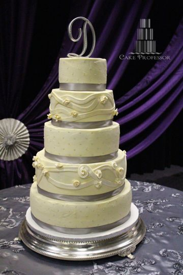 5-tier buttercream cake with silver ribbons