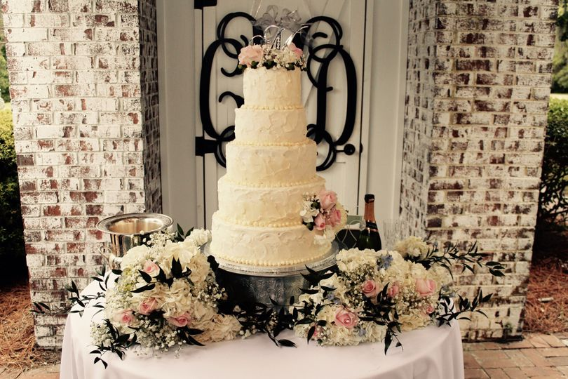 5-tier wedding cake with flowers on the table